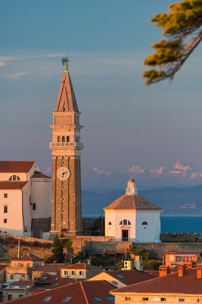 Piran church and Mt. Triglav in the background at sunset