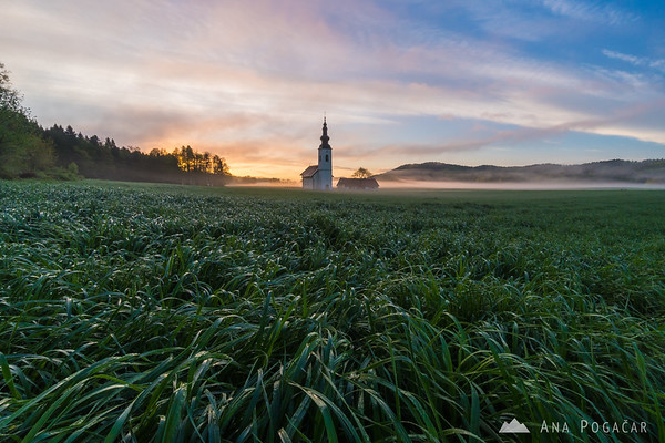 Misty sunrise at St. Jacob church near Hraše