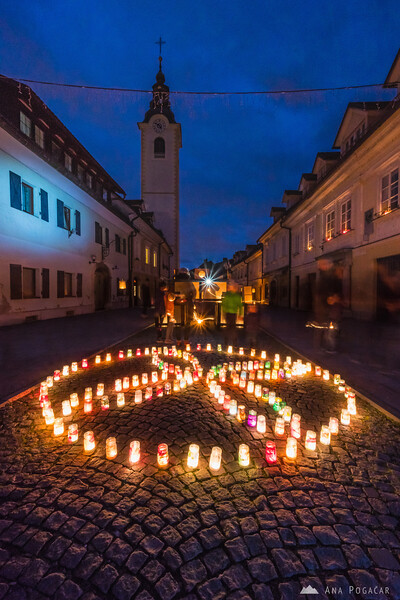 Ognjena Veronika - candles on Šutna street in Kamnik
