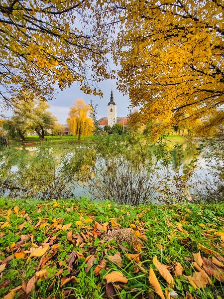 Church in Kostanjevica na Krki framed by fall colors