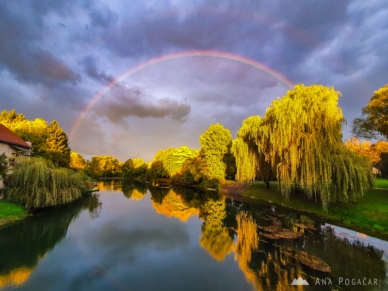 Dramatic skies with a rainbow over the Krka river