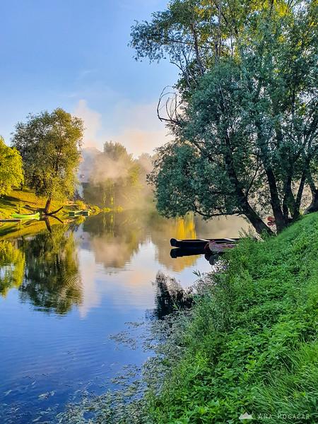 Boats on the misty Krka river