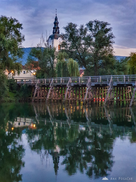 Old wooden bridge in Kostanjevica na Krki at dusk
