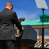 Secret Service affixing the Presidential Seal on the podium before the President's appearance.