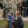 The widow of CPL Luxmore, killed in Afghanistan in June 2012, talks to their son at the memorial tree planted in his honor on Ft. Stewart's Warrior's Walk.