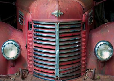 Truck An abandoned truck in a forgotten barn