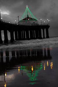"02-20-2013: Photo Credit - Dave Yamamoto. ""Pic I took over the holidays back in 2011... original pic was cool, but thought I'd be a bit artistic and convert it to b/w, color the lights and reflection. Manhattan Beach Pier."""