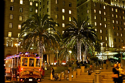 "03-07-2013:  Photo Credit Brittany Dean.  ""There is something about Christmas lights that bring me such joy. I love the warmth that it brings in the midst of winter. I was able to capture the beauty of the lights accentuating the trolly and palm trees in downtown San Francisco. There is something about the city...covered in lights...."""