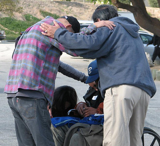 "03-25-2013: Photo Credit - LauraVern Shishido.  """"For where two or three come together in my name, there am I with them."" Matthew 18:20 Pastor Gary Fukumoto and Taryn Hiroshima praying with two of our homeless friends at God's Pantry Annual Thanksgiving Lunch 2011."""