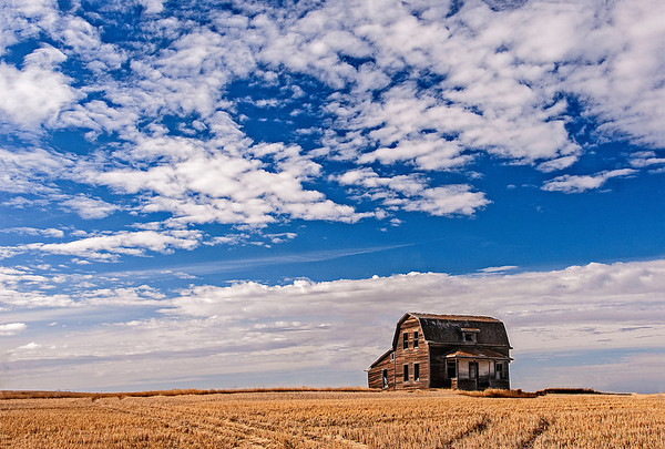 "Saskatchewan license plates include the caption ""Land of the Living Skies"".  These blue skies are only matched by the incredible sunrises and sunsets."