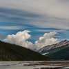 Twin clouds form over the Sunwapta River headwaters.