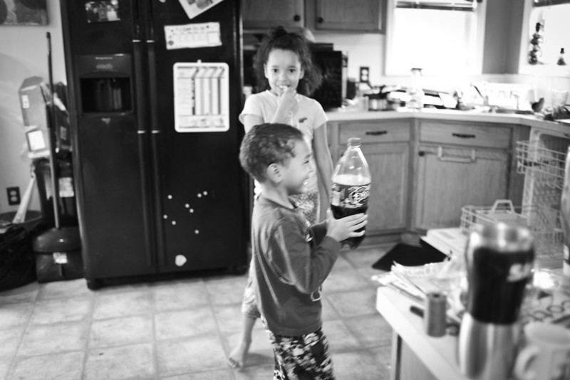 """<center>The kids and I came down stairs and needed to get working on cleaning up the kitchen...I wish I were one of those women that had a place for everything and everything was in it's place.  I'm not perfect but I think I do a pretty good job under my current circumstances.  Kyla just gave me the back story, I had just turned the corner...apparently Trey was shaking up the 2 liter soda saying """"Look at the volcano explode""""  ...I was wondering what the look on Kyla's face was about.....#MakingMemories </center>"""