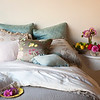 Note: Adagio and Satin Quilted are discontinued fabrics. Satin Quilted Euro Shams in Seaglass, Olivia Euro Shams in Flax over Satin Euro Slips in Pebble, Linen Whisper Pillowcase in Petal, Adagio Throw Pillow in Flax, Velvet with Satin Boudoir in Seaglass, Madera Sheets in Pebble, Madera Duvet Cover in Champagne, Homespun Coverlet in Flax, Olivia Boudoir in Champagne over Satin Boudoir in Pebble