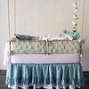Note: Betty and Amalie are discontinued fabrics. Betty Bumper in Sand, Bella Crib Sheet in Petal, Linen Whisper Crib Skirt in Pacific, Linen Crib Skirt in Petal, Linen Whisper Baby Blanket in Petal, Betty Baby Blanket in Pacific, Linen Whisper Kidney Pillow in Petal, Amalie Throw Pillow in Pacific