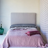Note: Rose Quartz is a discontinued color. Loulah Body Pillow in Pebble, Linen Fitted and Flat Sheet in Pebble, Velvet with Satin Quilted Coverlet in Rose Quartz, Loulah Kidney Pillow in Rose Quartz, Velvet headboard in Pebble yardage