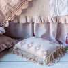 Note: Amalie is a discontinued fabric. Linen with Crochet Lace Duvet Cover in Perfect Peach, Amalie Coverlet in Petal, Linen with Crochet Lace Flat Sheet in White, Linen Dust Ruffle in Petal, Amalie Standard Sham in Perfect Peach, Amalie Throw Pillow in Petal, Olivia Boudoir in Perfect Peach over Linen Boudoir in White