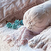 Note: Amalie is discontinued fabric. Linen with Crochet Lace Duvet Cover in Perfect Peach, Amalie Coverlet in Petal, Olivia Bolster in Petal over Linen Bolster in Perfect Peach, Linen with Crochet Lace Flat Sheet in White, Amalie Euro Sham in Petal