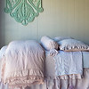 Note: Amalie is a discontinued fabric. Linen with Crochet Lace Duvet Cover in Perfect Peach, Amalie Coverlet in Petal, Amalie Euro Shams in Petal, Olivia Bolster in Petal over Linen Bolster in Perfect Peach, Linen with Crochet Lace Flat Sheet in White, Linen Fitted Sheet in White, Linen Dust Ruffle in Petal