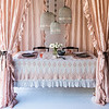 Olivia Tablecloth in Perfect Peach over Linen Whisper Tablecloth in Pebble, Silk Velvet Quilted Place Mats in Perfect Peach, Linen Whisper Napkins in Pebble, Linen Whisper Curtains in Perfect Peach