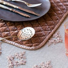 Olivia Tablecloth in Perfect Peach over Linen Whisper Tablecloth in Pebble, Silk Velvet Quilted Place Mat in Perfect Peach