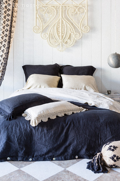 Homespun Standard Shams in Ebony, Satin Standard Pillowcases in Sand, Linen Queen Fitted and Flat Sheet in Sand, Linen Queen Duvet Cover in Ebony, Linen with Crochet Lace Deluxe Sham in Ebony, Linen with Crochet Lace Kidney Pillow in Sand, Olivia Bolster in Ebony over Linen Bolster in Sand, Olivia Curtain in Ebony