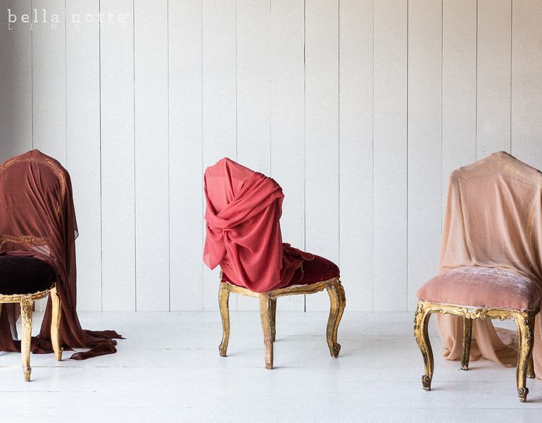 Note: Bordeaux and Coral are discontinued colors. Silk Velvet upholstered chairs draped in Valentina Gauze Yardage in Bordeaux, Coral, and Perfect Peach
