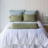 Linen Quilted Euro Shams in Seaglass, Homespun Standard Shams in Bottle Green, Linen Queen Duvet Cover in White, Linen Bolster in Bottle Green, Linen Dust Ruffle in White