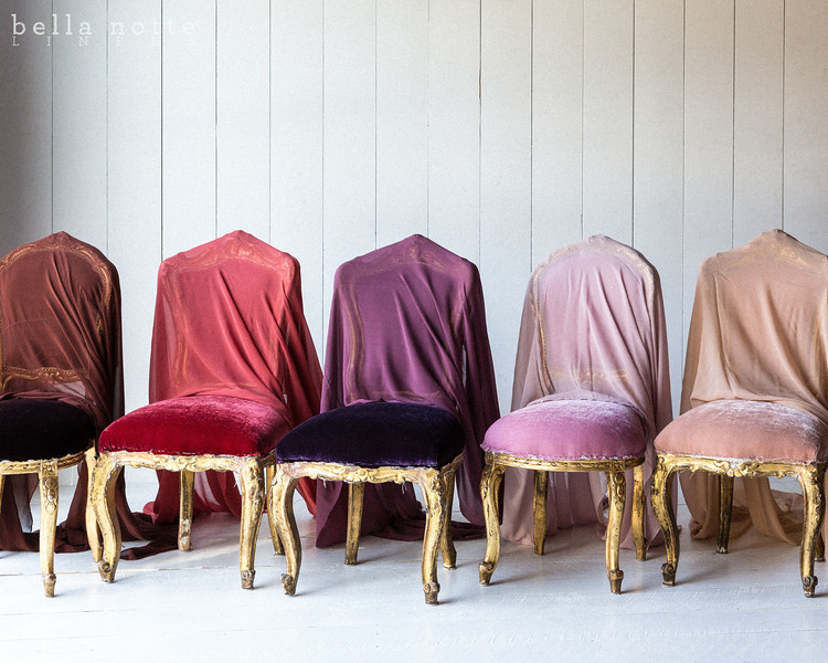 Note: Bordeaux, Coral, Amethyst and Rose Quartz are discontinued colors. Silk Velvet upholstered chairs draped in, from left to right, Valentina Gauze Yardage in Bordeaux, Coral, Amethyst, Rose Quart and Perfect Peach