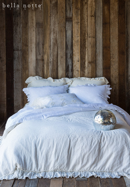 Note: Allysa is a discontinued fabric. Linen Whisper Euro Shams in Champagne, Allysa Standard Shams in White, Olivia Standard Pillowcase in Champagne over Linen Standard Pillowcase in White, Linen Queen Fitted and Flat Sheet in White, Linen Whisper Queen Duvet Cover in Champagne
