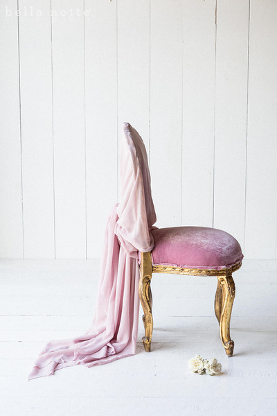 Note: Rose Quartz is a discontinued color. Silk Velvet upholstered chair draped in Valentina Gauze in Rose Quartz