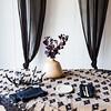 Olivia Tablecloth in Ebony over Linen Whisper Tablecloth in Sand, Linen Whisper Napkins in Ebony, Valentina Curtains in Ebony