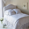 Mirabella Deluxe Shams in White, Mirabella Euro Shams in White, Mirabella Standard Shams in White, Mirabella Queen Duvet Cover in White, Madera Queen Fitted Sheet in White, Madera Queen Flat Sheet in White, Linen Queen Dust Ruffle in White, Mirabella Personal Comforter in White, Linen Whisper Curtain in White, Headboard upholstered with Linen Whisper Yardage in White
