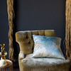 Ophelia Throw Pillow in Cool and chair upholstered with Silk Velvet Yardage in Ginger