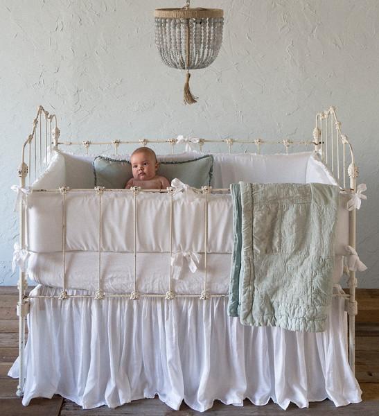 Helane Bumper in White, Linen Crib Sheet in White, Satin Crib Skirt in White, Helane Kidney Pillow in Thyme, Helane Baby Blanket in Thyme, Emerson Baby Comforter in Thyme