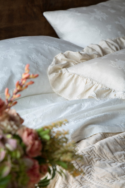Isabella Pillowcases in Winter White, Isabella Kidney Pillow in Sand, Isabella Flat Sheet in Winter White, Marseille Coverlet in Sand