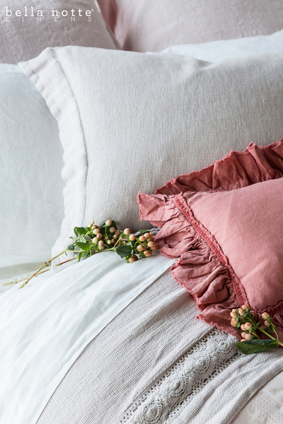 Note: Coral is discontinued color and Allysa is a discontinued fabric. Hayden Euros in Petal, Homespun Standard Sham in White, Alyssa Kidney Pillow in Coral, Linen Flat Sheet in White, Homespun Coverlet in Pebble