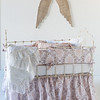 Zia Crib Bumper in Warm, Zia Baby Dust Ruffle in Warm, Linen Crib Sheet in White, Linen Whisper Baby Blanket in White, Linen Whisper Kidney Pillow in White,<br /> Valentina Kidney Pillow in Perfect Peach