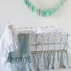 Zia Crib Bumper in Cool, Zia Baby Dust Ruffle in Cool, Linen Crib Sheet in White, Linen Whisper Baby Blanket in White, Linen Whisper Baby Blanket in Seaglass, Linen Whisper Kidney Pillow in White