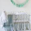 Zia Crib Bumper in Cool, Zia Baby Dust Ruffle in Cool, Linen Crib Sheet in White, Linen Whisper Baby Blanket in White, Linen Whisper Baby Blanket in Seaglass, Linen Whisper Kidney Pillow in White