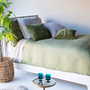 "Madera Queen Duvet Cover in Bottle Green, Madera Queen Fitted Sheet in Flax, Madera Queen Flat Sheet in Flax, Madera Deluxe Shams in Bottle Green, Madera Euro Shams in Flax, Hendrix 20"" Throw Pillows in Bottle Green"