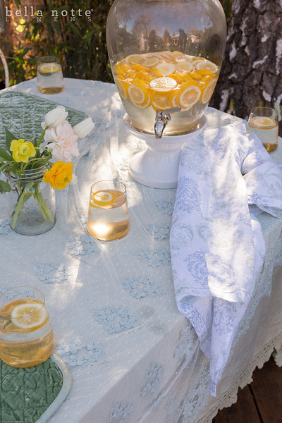 Olivia Tablecloth in Seaglass over Linen Crochet Lace Tablecloth in Mint Julep, Silk Velvet Quilted Placemats in Mint Julep, Zia Guest Towel in Cool
