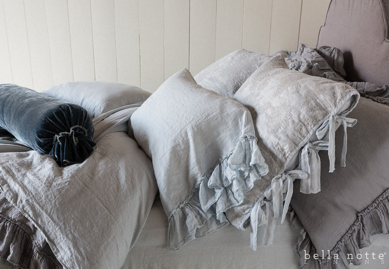 Linen Whisper Deluxe Shams in Mineral, Marguerite Euros in Silvermist, Linen Whisper Standard Shams in Silvermist. Linen Queen Flat Sheet in Silvermist, Linen Queen Fitted Sheet in Silvermist, Loulah Bolster in Mineral, Linen Whisper Queen Duvet Cover in Mineral,