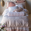 Mirabella Queen Duvet Cover in Heirloom Rose Madera Queen Fitted Sheet in White, Madera Queen Flat Sheet in White, <br /> Mirabella Deluxe Shams in Heirloom Rose, Loulah Euro Shams in Heirloom Rose, Olivia Standard Pillowcase in Heirloom Rose over Satin Standard Pillowcase in White, Olivia Queen Coverlet in White, Linen Whisper Queen Dust Ruffle in Heirloom Rose, Olivia Bolster in White over Linen Bolster in Heirloom Rose, Valentina Standard Shams in White, Valentina Kidney Pillow in Heirloom Rose