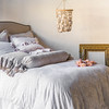 Lillian Deluxe Shams in Pebble, Lillian Euro Shams in White, Gabriella Kidney Pillow in Powder, Gabriella Pillowcase in Fog, Gabriella Bolster in Fog, Linen Flat Sheet in White, Lillian Duvet Cover in White, Linen Bed Skirt in White