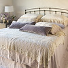 Seville Royal Shams in Powder, Linen Whisper Deluxe Shams in Parchment, Olivia King Pillowcases in Powder, Satin with Venise Lace King Pillowcases in Parchment, Carmen Lumbar Pillows in Powder, Seville King Bedspread in Powder, Olivia Bed Throw in Parchment, Seville King Bed Skirt in Powder