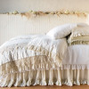 Loulah Deluxe Sham in Parchment, Frida Euro Sham in White, Linen Whisper Standard Pillowcase in Parchment, Linen Whisper Queen Coverlet in White, Linen Whisper Queen Duvet Cover in Parchment, Frida Wedding Blanket in Parchment, Linen Whisper Queen Bed Skirt in Parchment