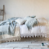Frida Deluxe Sham in Parchment, Frida Standard Pillowcases in Eucalyptus, Seville Embroidered Accent Pillows in Parchment, Frida Queen Duvet Cover in White, Frida Wedding Blanket in Parchment, Linen Whisper Wedding Blanket in Eucalyptus