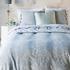 Seville Royal Shams in White, Marguerite Euro Shams in Cloud, Paloma Euro Sham in Eucalyptus, Linen King Flat Sheet in White, Marguerite King Duvet Cover in Cloud