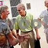 Beck Diefenbach  -  bdiefenbach@daily-chronicle.com<br /> <br /> DeKalb native and NBC Sports golf analyst Mark Rolfing (center) shares a laugh with former coworkers Steve Arnold, left, and Skeeter Jacobson, right, during a reunion of former Hopkins pool employees at Hopkins Pool in DeKalb, Ill., on Tuesday Aug. 17, 2009. Rolfing will be announcing at this week's Solheim Cup.