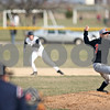 Beck Diefenbach  -  bdiefenbach@daily-chronicle.com<br /> <br /> DeKalb pitcher Alex Jaquez winds up  during the sixth inning of the game against Sycamore at Sycamore Community Park in Sycamore, Ill., on Wednesday April 8, 2009.